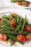 Haricot vert och tomatsallad Arkivfoton