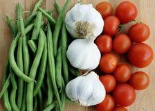 Haricot vert, vitlök och körsbärsröda tomater Royaltyfria Foton