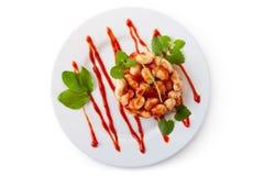 Haricots blancs en sauce tomate sur un paraboloïde Photographie stock libre de droits