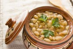 Haricots cuits au four dans un pot Photo stock