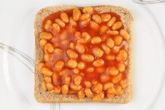 Haricots cuits au four sur le pain grillé Photos libres de droits