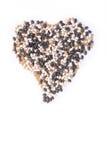 Haricots dans la forme de coeur sur le fond blanc Photographie stock libre de droits