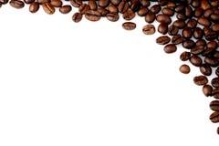Haricots de Cofee sur un fond blanc Photos libres de droits