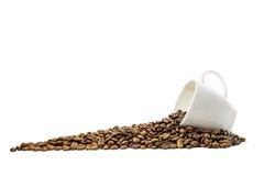 Haricots de Coffe avec la tasse Photos stock