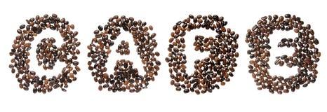 Haricots de Coffe employés pour orthographier le café de mot Photos stock