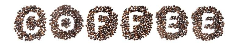 Haricots de Coffe employés pour orthographier le café de mot Images stock