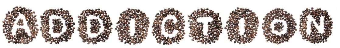Haricots de Coffe employés pour orthographier le penchant de mot Photos stock