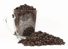 Haricots de Coffe et tasse en verre Photos stock