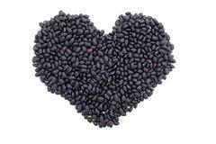 Haricots de tortue noirs dans une forme de coeur Photographie stock