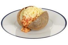 Haricots et pomme de terre en robe de chambre cuits au four de fromage Photos libres de droits