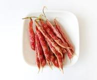 Haricots repérés rouges sur le blanc Photographie stock libre de droits