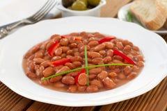 Haricots rouges avec le poivron rouge en sauce images stock