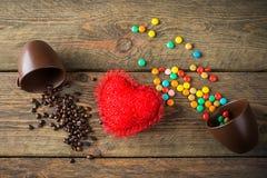 Haricots, sucreries et coeur rouge Images stock