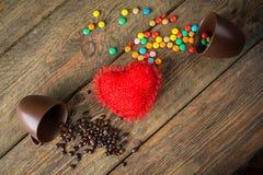Haricots, sucreries et coeur rouge Image stock