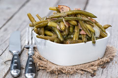 Haricots verts avec le lard Photo stock