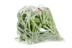 Haricots verts frais dans un sac Photos stock