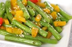 Haricots verts frits par Stir Photos stock