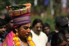 Haridasa go around singing Hindu god hari prayers during pongal Stock Photo