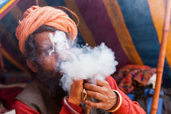 Blowing pilgrim at Kumbh Mela Royalty Free Stock Image