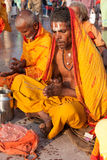 Pilgrims pray after morning bath in Ganges at Kumbh Mela Stock Photo