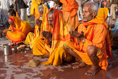 Pilgrims pray after morning bath in Ganges at Kumbh Mela Stock Photos