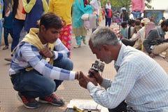 Street tattoo studio on the Ganga riverbank in Haridwar. royalty free stock photos