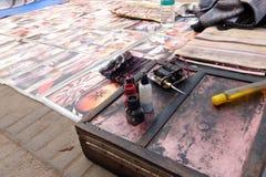Street tattoo studio on the Ganga riverbank in Haridwar. stock photos