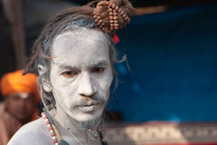 Portrait of young naga sadhu at Kumbh Mela Royalty Free Stock Photos