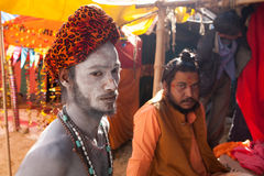 Portrait of young naga sadhu at Kumbh Mela Stock Images