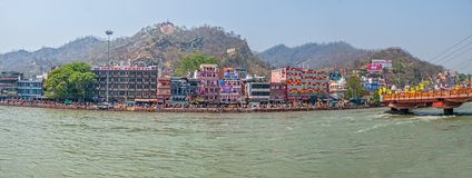 Haridwar panorama. HARIDWAR, INDIA - APRIL 15, 2010: Buildings and hotels on the banks of the river Ganges in time of Kumbh Melam Royalty Free Stock Photos