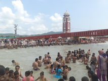 Haridwar. People taking a holy dip in the sacred river Ganges in Haridwar, Uttarakhand, India Stock Image