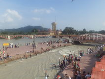 Haridwar. People taking a holy dip in the sacred river Ganges in Haridwar, Uttarakhand, India Stock Photos