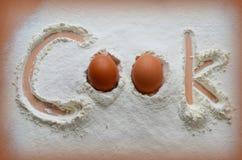 Harina y dos huevos Foto de archivo libre de regalías