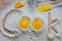 Harina y dos huevos Imagenes de archivo