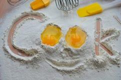 Harina y dos huevos Imagen de archivo