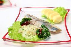 Haringen met groenten Stock Afbeeldingen