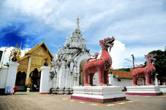 Hariphunchai Temple. Wat Phra That Hariphunchai's earliest origins were in 897 when the then king of Hariphunchai is said to have built a stupa (now the central Stock Photo