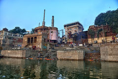 Harishchandra Ghats in Varanasi. Dawn View of Harishchandra Ghat which is the secondary cremation ghat in Varanasi on the Ganges River Royalty Free Stock Photography