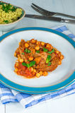 Harissa lamb chops with chickpeas and minted couscous Stock Images