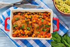 Harissa lamb chops with chickpeas and minted couscous Stock Image