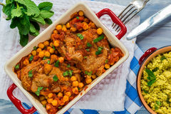 Harissa lamb chops with chickpeas and minted couscous Royalty Free Stock Photos