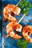 Harissa spice mix - morrocan red hot chilles with king prawns Royalty Free Stock Image