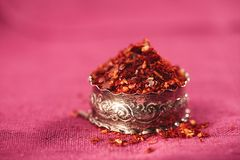 Harissa spice mix - morrocan red hot chilles mixed. Traditional  harissa spice mix  - morrocan red hot chilles mixed in silver plate Royalty Free Stock Photo