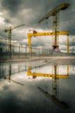 Harland & Wolff shipyard. Lifting cranes of Harland & Wolff shipyard reflecting on water in the foreground, Belfast, Northern Ireland royalty free stock photos