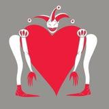 Harlekin mit Herzen auf einem grauen Hintergrund Lizenzfreies Stockbild