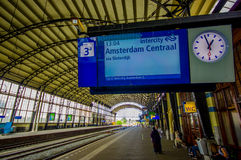 Harlem, Amsterdam, Netherlands - July 14, 2015: Closeup train station sign over platform showing next departure Royalty Free Stock Photography