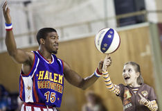 Harlem Globetrotters. CLUJ-NAPOCA - MARCH 25: The world famous Harlem Globetrotters basketball team in an exhibition match against Washington Generals on March Royalty Free Stock Images