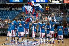 Harlem Globetrotters. SACRAMENTO, CA - January 15: The Harlem Globetrotters remove their workout pants before the game against the International Elite at Power Stock Image