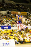 Harlem Globetrotters Basketball Action (Blurred). Image of Hi Rise Brown of the world famous Harlem Globetrotters basketball team in action against Washington Royalty Free Stock Images