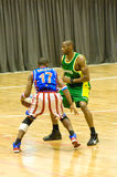 Harlem Globetrotters basketball team. BUCHAREST - MARCH 26: The world famous Harlem Globetrotters basketball team in an exhibition match against Washington Stock Images